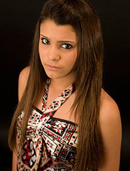 Dominique Gomez- Pop Singer Trained by Vocal Coach Thomas Appell at APPELL VOICE STUDIO in Orange County, CA